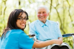caregiver escorting her patient